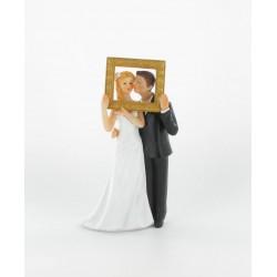 Figurine de mariés dans cadre
